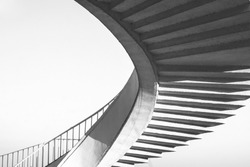 Black and white spiral stairs abstract. Round steps near the Gdanski bridge, Warsaw, Poland