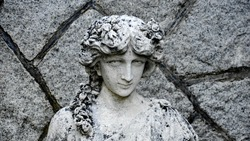 Black and white statue of a Grecian woman, stone work, at a Castle