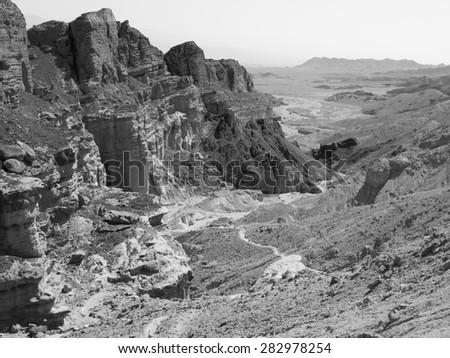 Black and white stone desert mountains cliffs, Arava, Negev desert, Israel.