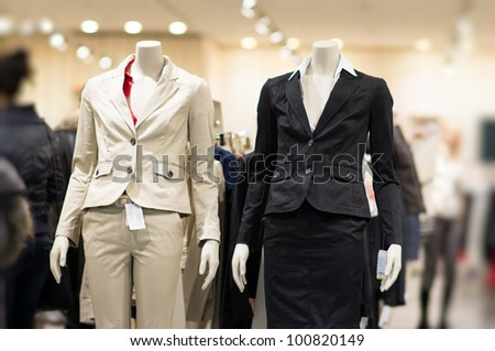 Black and white suits on mannequins in mall