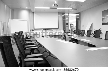 black and white, table and chairs in the boardroom