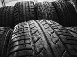 Black and white tires in the pan. Tires are arranged next to each other, close-ups