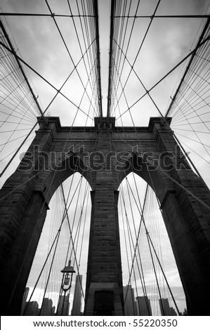 Black and white upward image of Brooklyn Bridge in New York - stock photo