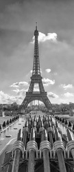 Black and white view of Eiffel Tower in Paris, France.