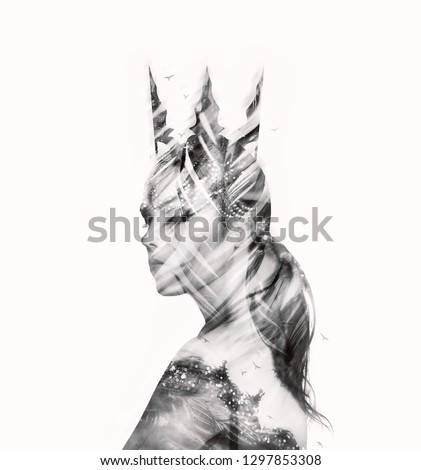 Stock Photo Black and white visual digital art. Stylish gothic dark queen lady in a crown and luxury dress made of feathers, jewelry and lines. Double exposure effects. Isolated on white