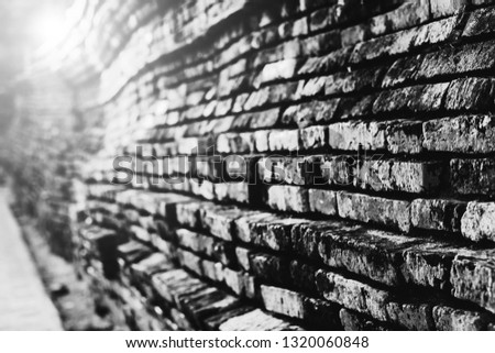 Black and white Wall of ancient asian archaeological site in Asia for historical tourist. Landmark of ayutthaya landmark wat in Thailand with old ruin Buddha statue