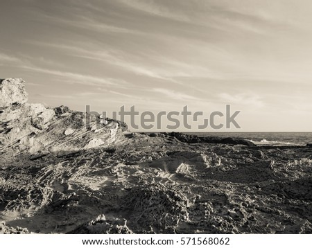 Black and white wallpaper of amazing mountain near the sea #571568062