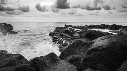 Black and white waves crashing on rocks in Mauritius.