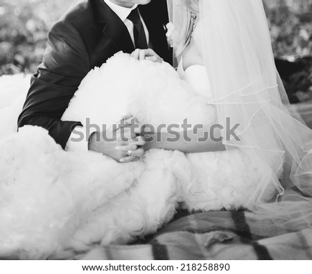 Black and white wedding picture. Newlywed couple holding hands,   #218258890