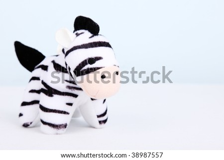 Black and white zebra over white background. Toy animal