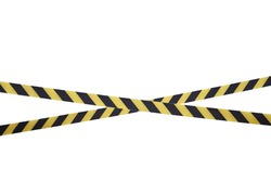 Black and yellow lines of barrier tape prohibit passage. Barrier tape on white isolate. Barrier that prohibits traffic. Warning tape. Danger unsafe area warning do not enter. Concept of no entry