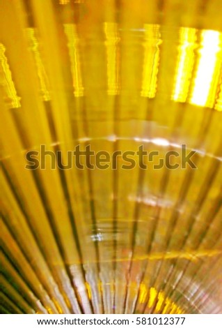 Black and yellow vertical abstract sunny lines. Glowing sun vertical rays, glow in the dark, color glow #581012377