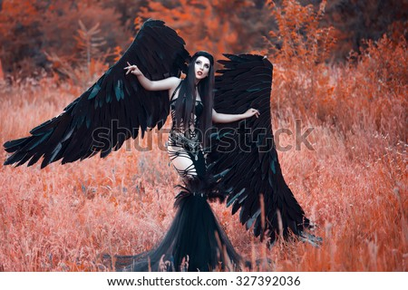 Black Angel. Pretty girl-demon with black wings. An image for Halloween. Image of an old book of fairy tales. Fashionable toning with noise