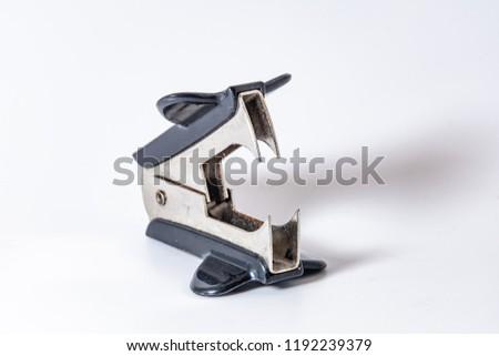 Black anti-stapler over white background