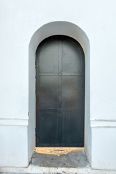 black are the doors of the temple. arched vault. closed door Orthodox Church, Russia. Krasnoyarsk