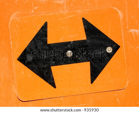 Black arrows pointing in opposite directions. - stock photo