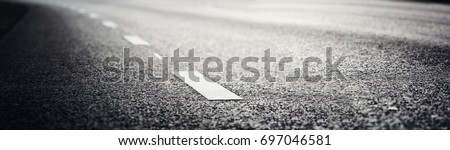 black asphalt road and white dividing lines