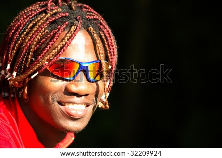 Black athlete cyclist in sunglasses
