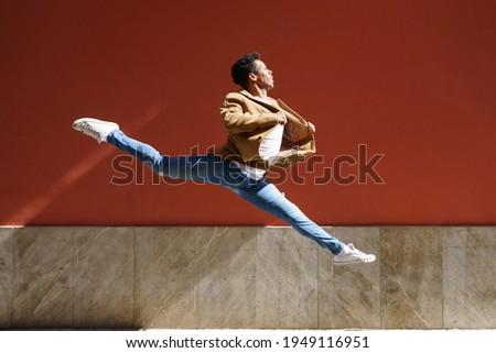 Black athletic man doing an acrobatic jump outdoors Stockfoto ©