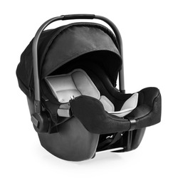 Black Baby Carrier Isolated on White Background. Modern Restraining Car Seat with Side Impact Protection. Travel Gear. Infant Restraint. Side View of Child Safety Seat System