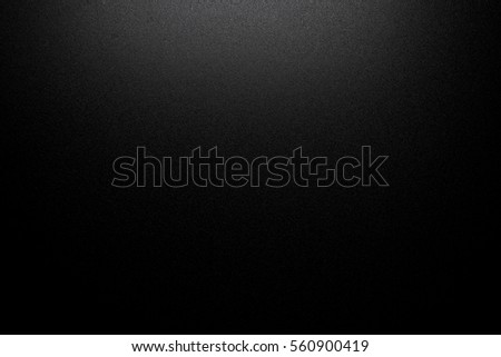 Black background dark texture pattern. Shiny paper elegant studio with space.