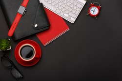 black background red coffee cup note pad alarm clock flower diary scars keyboard corner