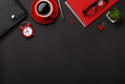 black background red coffee cup note pad alarm clock flower diary scores keyboard
