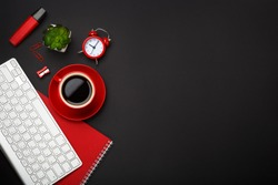 black background red coffee cup note pad alarm clock flower keyboard
