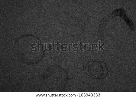 Black background with cup stains