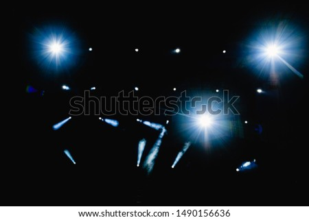 Black background with light bulbs illuminating the darkness with sparkles.