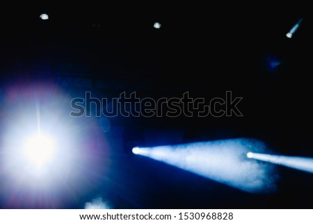 Black background with light bulbs illuminating the darkness with sparkles. #1530968828