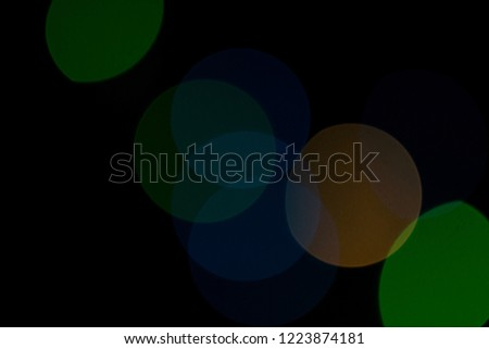 Black background with multicolored bokeh for Christmas backgrounds and screensavers. #1223874181