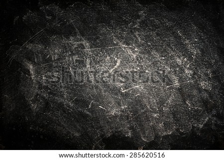 Black Background with vignetting, horizontal. Border frame on white gray background with dirty grunge texture. Dark grunge textured wall closeup