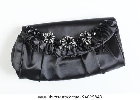 black bag on white table - stock photo