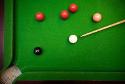 black ball shot in snooker game. top view