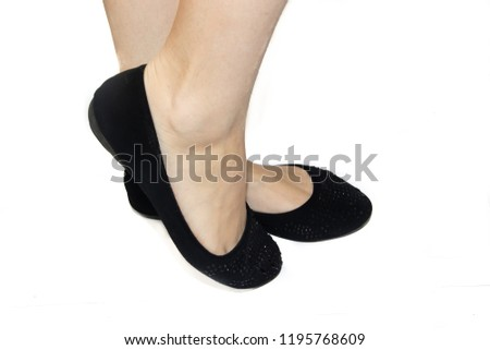 387654c0aca Black ballet flats on female legs on a white background. Women s summer  footwear. Business