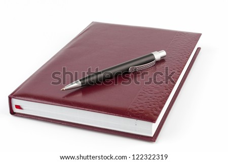 Black ballpoint pen on the leather cover diary