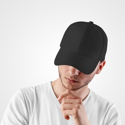 Black baseball cap template for sports, on the head of a guy with a beard, isolated on background.Mockup of blank headdress for sun protection, fashionable panama with visor,for presentation of design