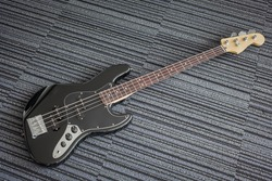 Black bass guitar on the floor