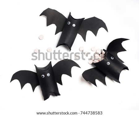 Stock Photo black bats from rolls on toilet paper. DIY fun with kids, sweets for halloween