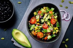 Black beans corn avocado red onion tomato salad with lime dressing. toning. selective focus