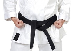 Black belt karate expert with rest position