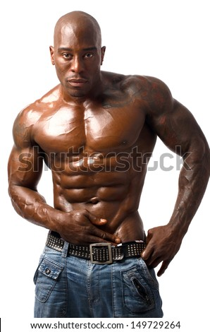 Black bodybuilder topless. Black bodybuilder wearing a vest. Strong man with perfect abs, pecs shoulders,biceps, triceps. Isolated on white background
