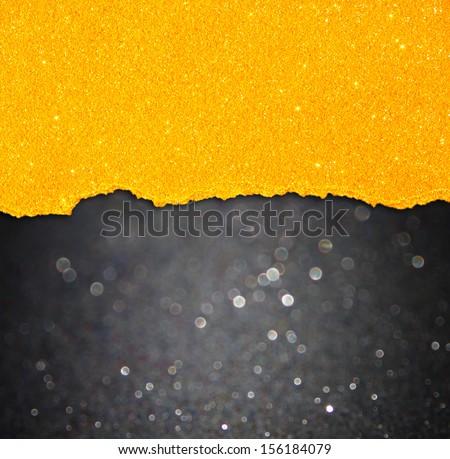 black bokeh lights and orange torn paper