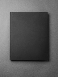 Black book cover on the gray background.