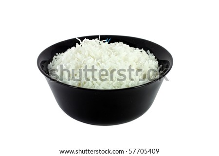 Black bowl full of coconut meal isolated on white
