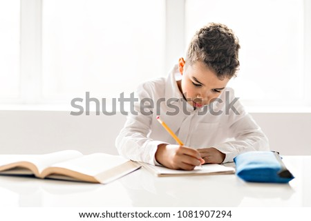 Black boy doing homework at home