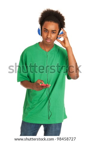 Black boy is listening to music from his smart phone - stock photo