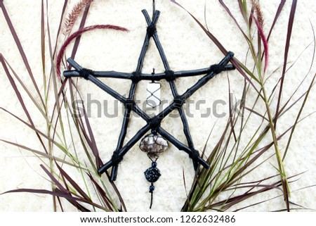 Black Branch Pentagram symbol for Witchcraft, Wicca, Paganism with selenite, smoky quartz and snowflake obsidian against cream background