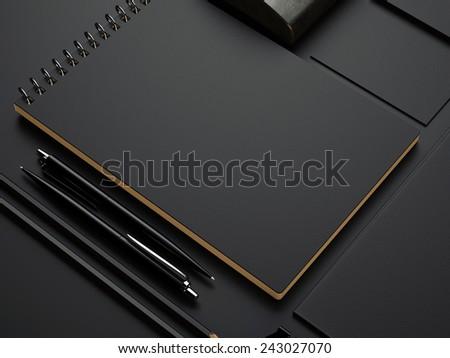 black branding elements on black paper background